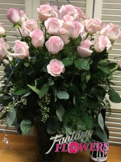 24 Soft pink roses.